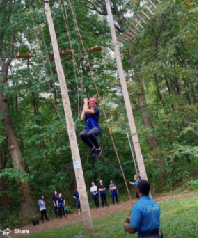 Student on the ropes course