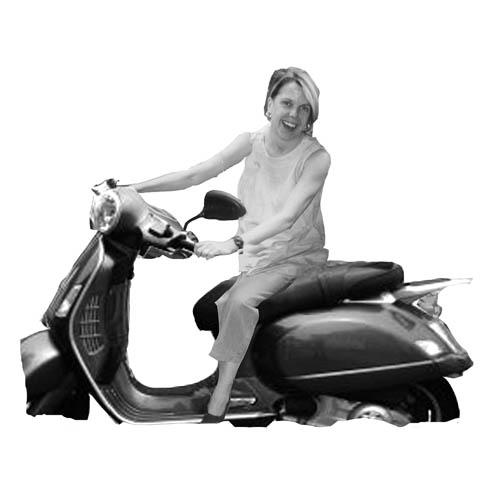 Gaynor McCown Riding a Scooter