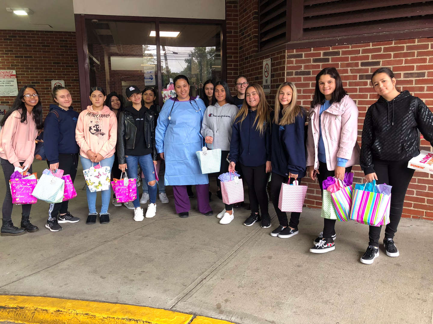Group of students bring gifts to healthcare workers