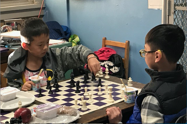 Two students begin their chess game.