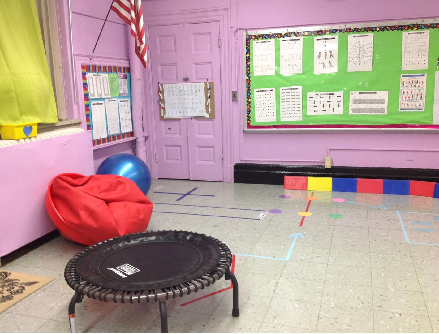 Mini-trampoline and a bean bag provide physical activities.