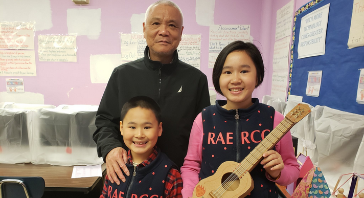 A family proudly shares a Maker Space Showcase project.