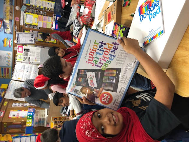 Grade 3 student opens her holiday gift