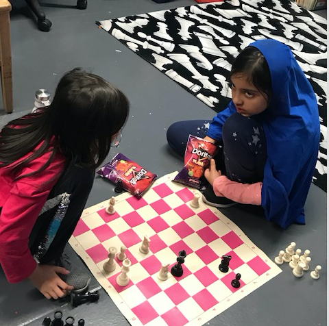 Female students focus on their game.