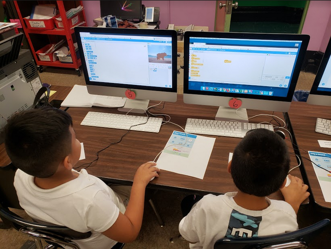 3rd Grade student practice coding with Scratch