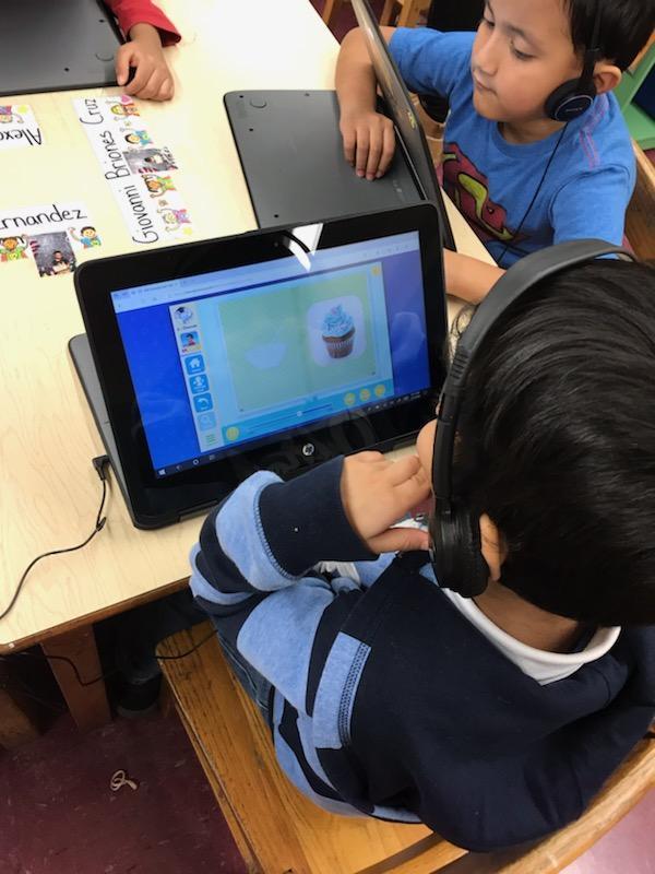 PreK student using his laptop.