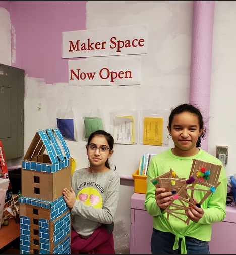 Two students share their finished Maker space projects. Towers