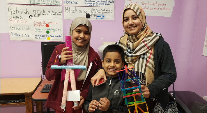A Maker Space Showcase family proudly share their Tower project