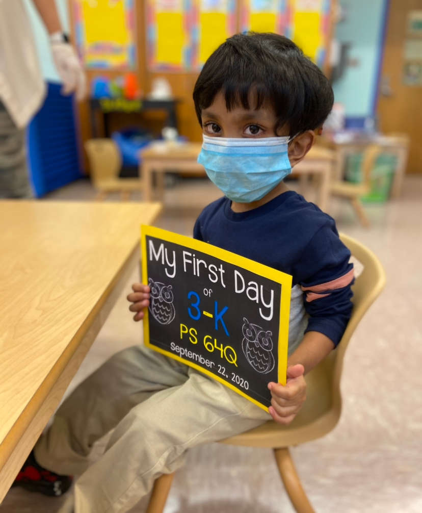 3-K student with a sign on his first day of school