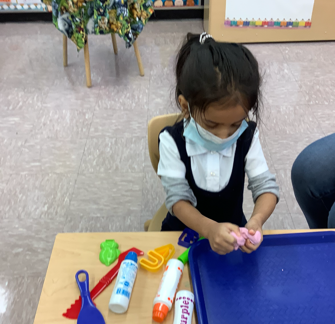 a female student with play doh