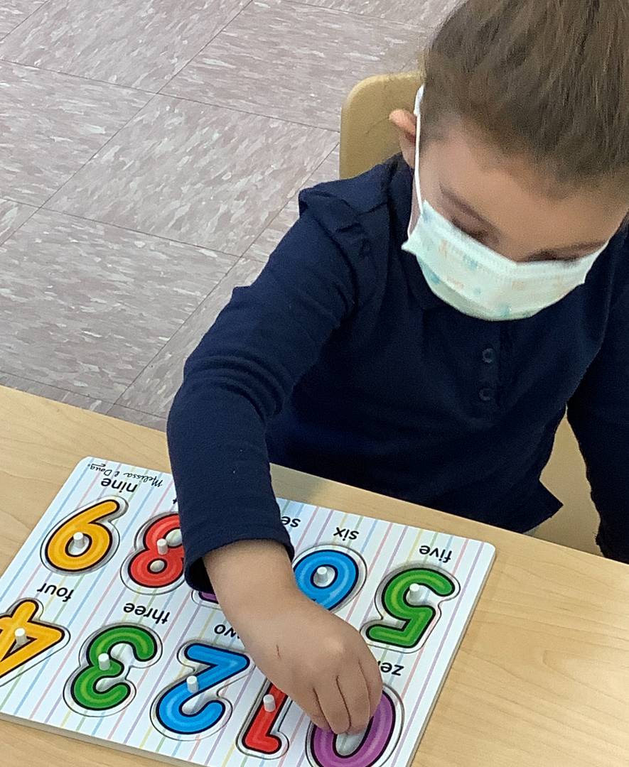a student doing a number puzzle
