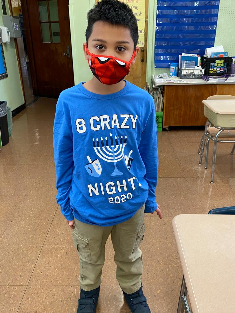 a hanukah shirt on a second grader
