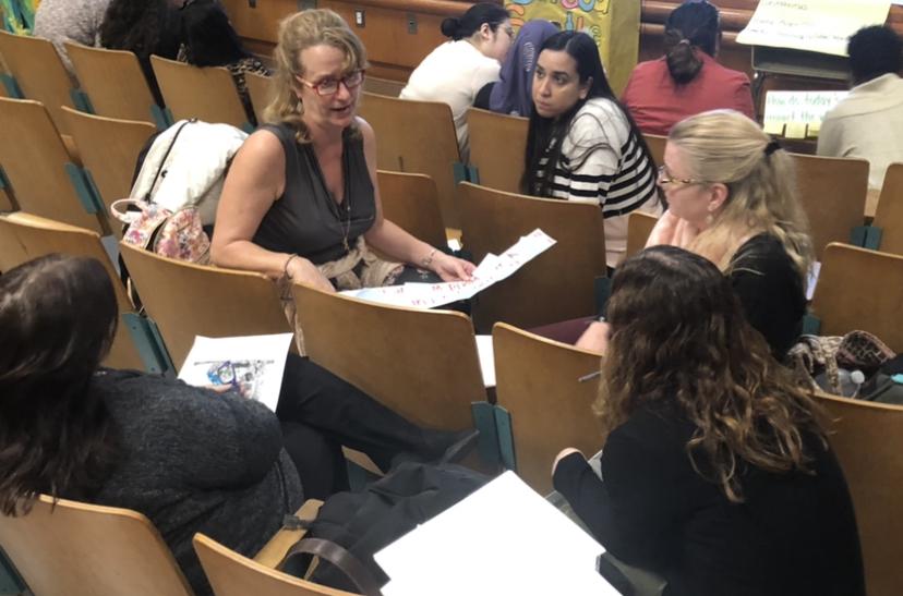 teachers talking in the auditorium