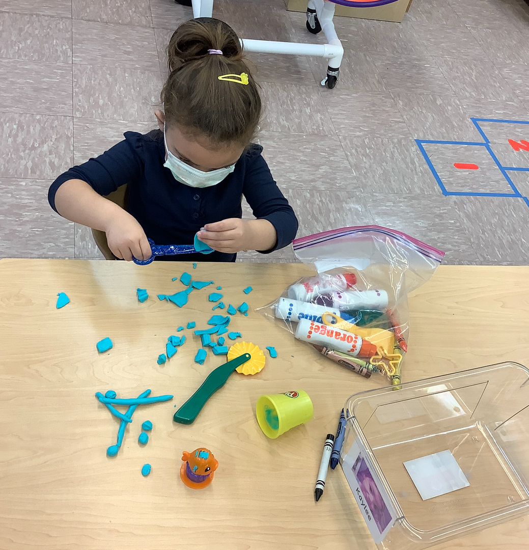 a student with math manipulatives