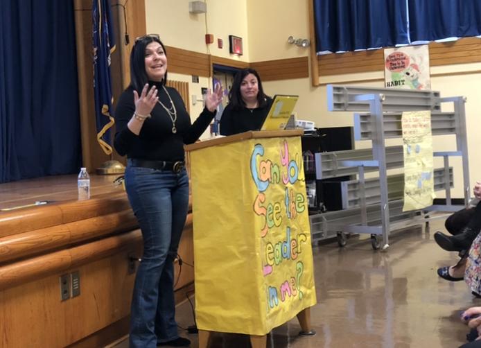 teachers at the podium in the auditorium