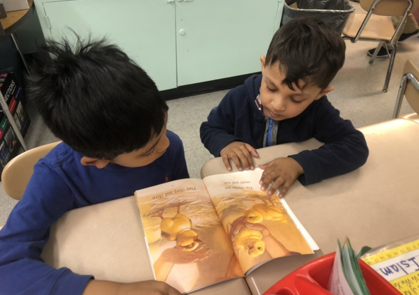 two students sharing a story