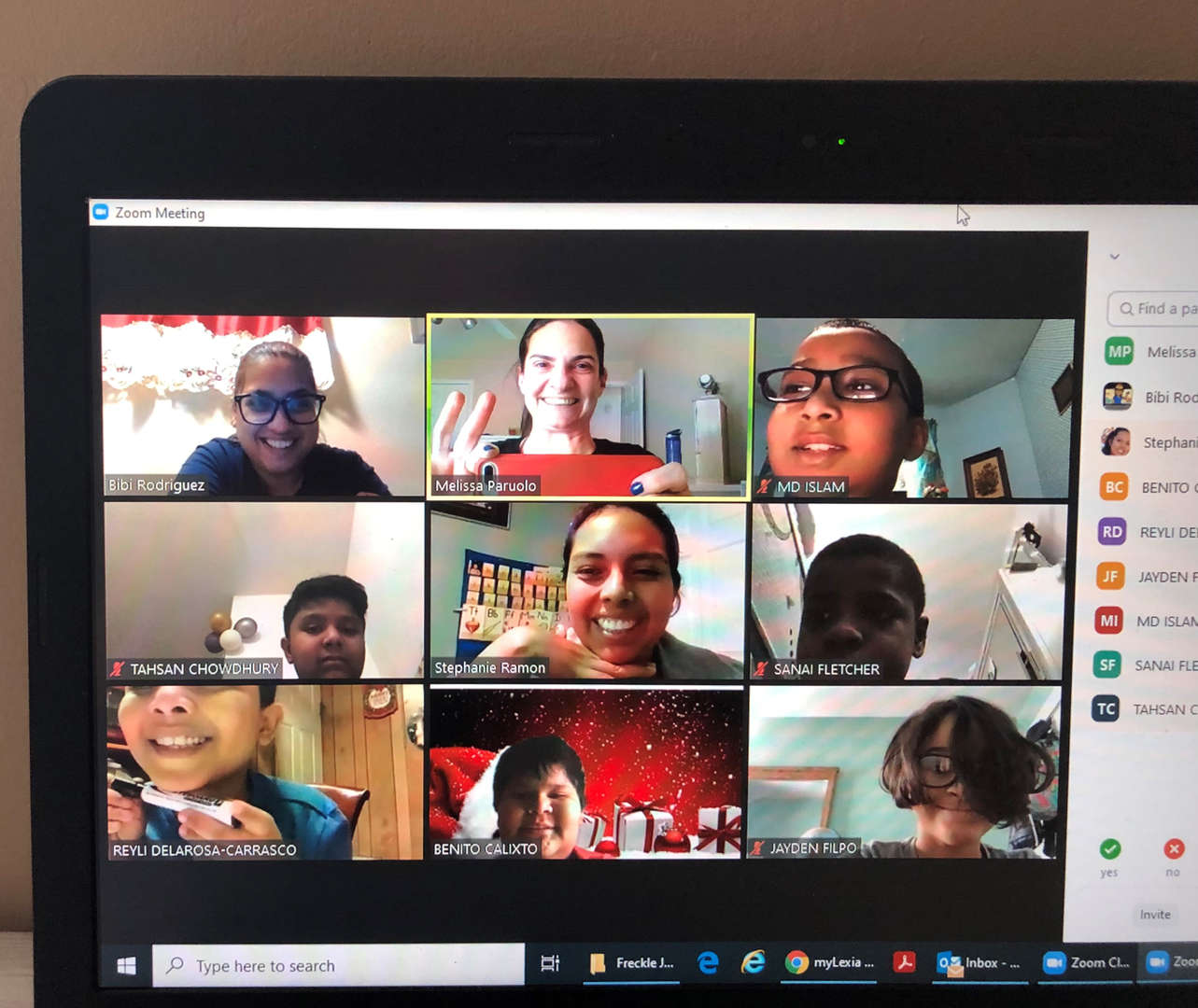 a zoom class with 9 students smiling