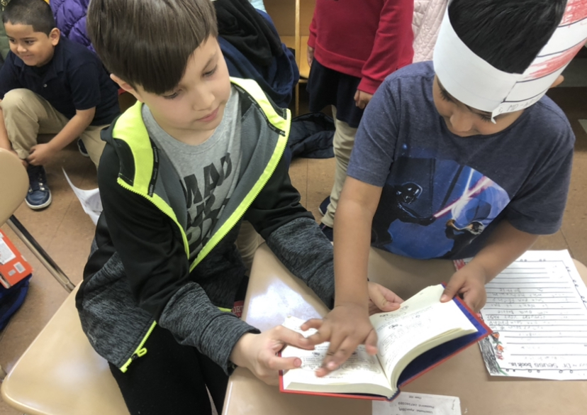 two students reading together