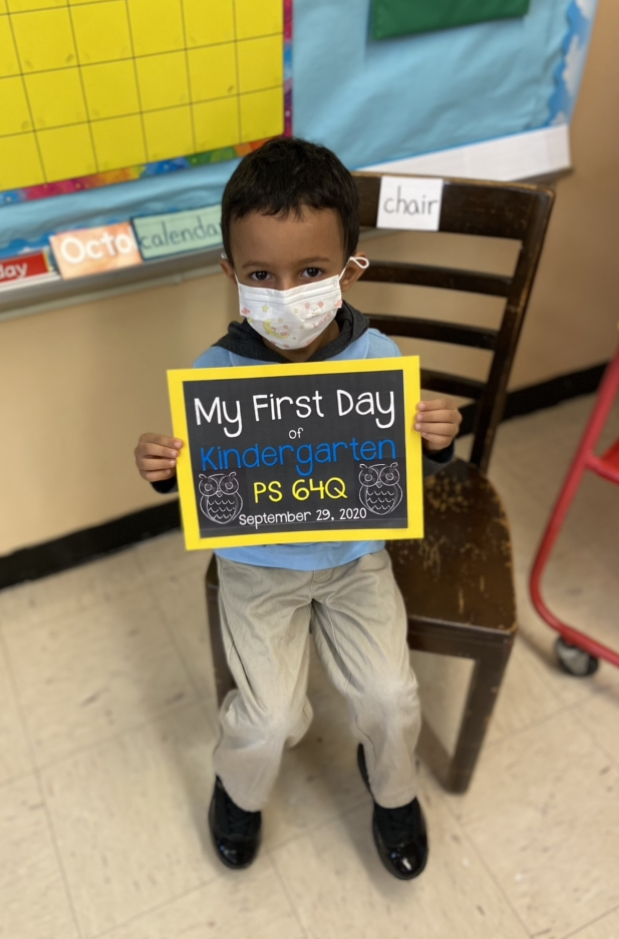 first day of school photo for a kindergarten student with a mask