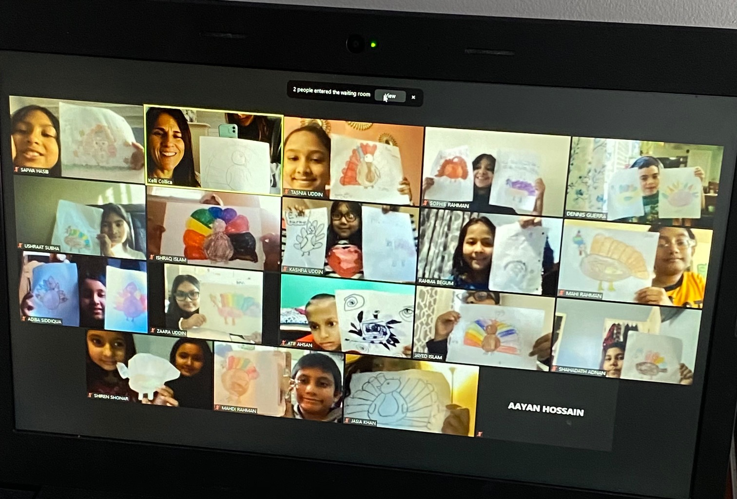 A zoom screen with students showing their work.