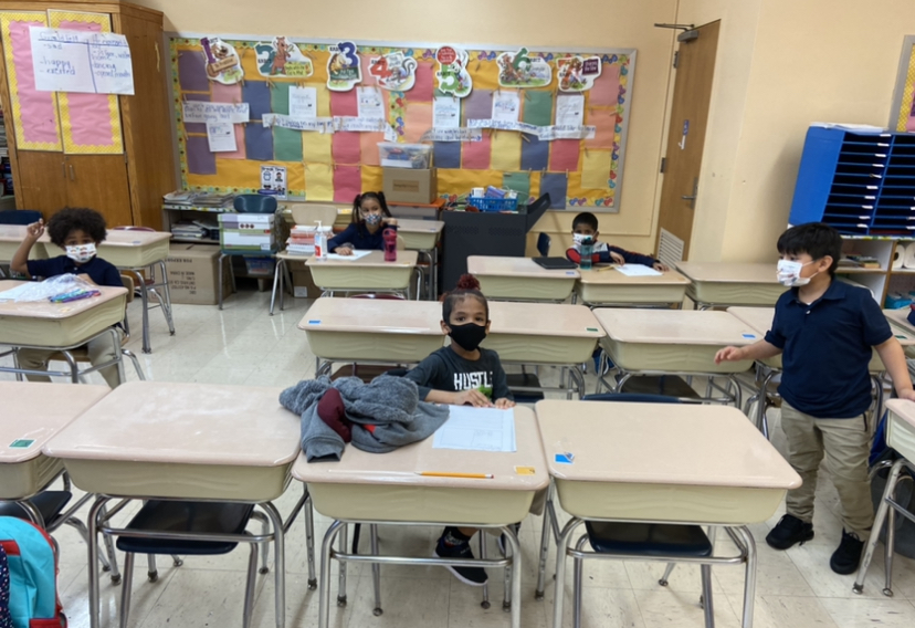 Third graders at their seats