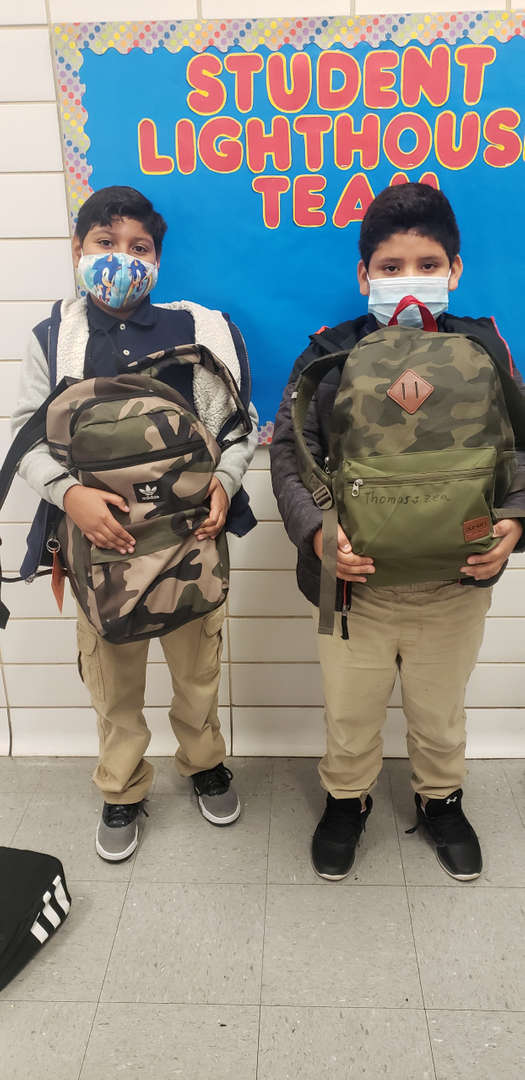 students with their camouflage backpacks