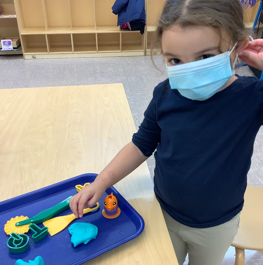 a female student with sensory materials