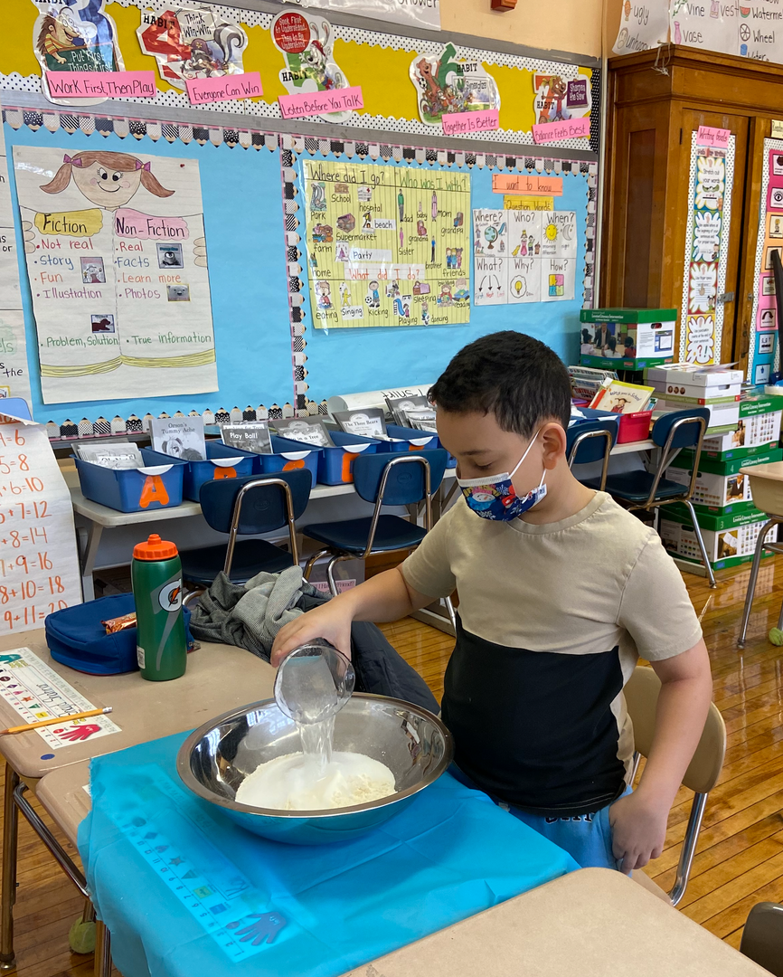 a male student with water and a bowl