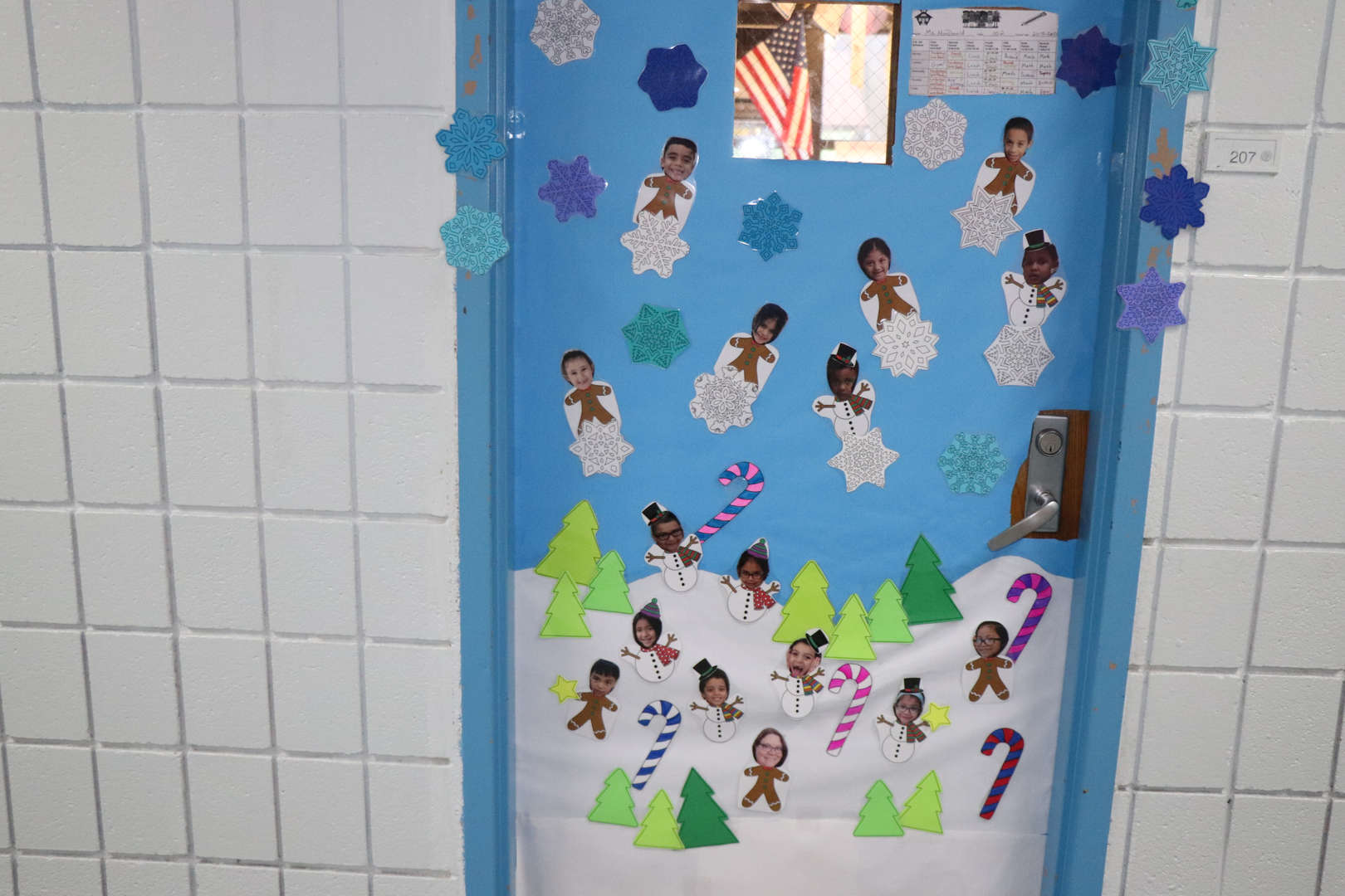 A classroom door decorated for the holidays.