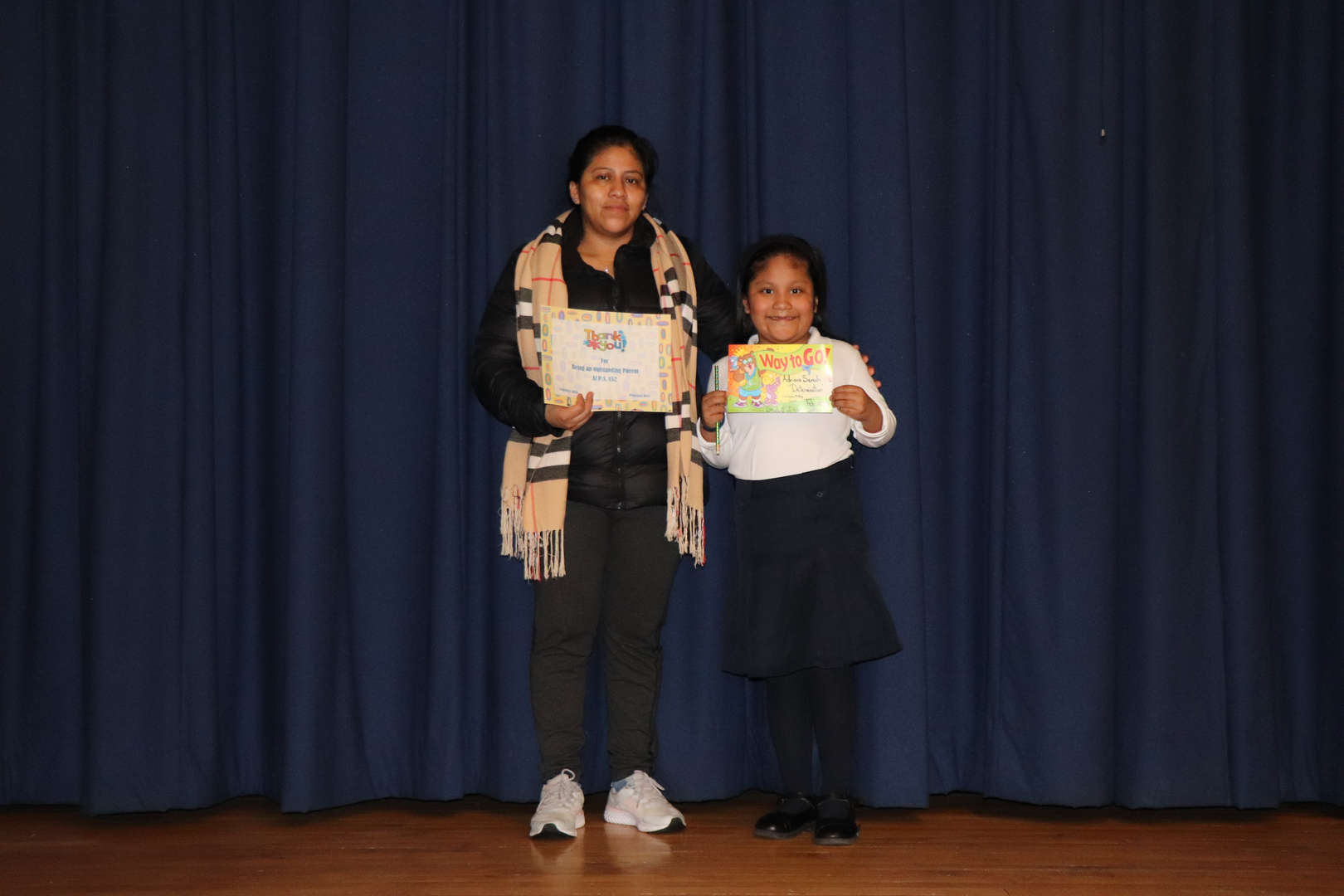 Second Grade Parent with her child who is student of the month.