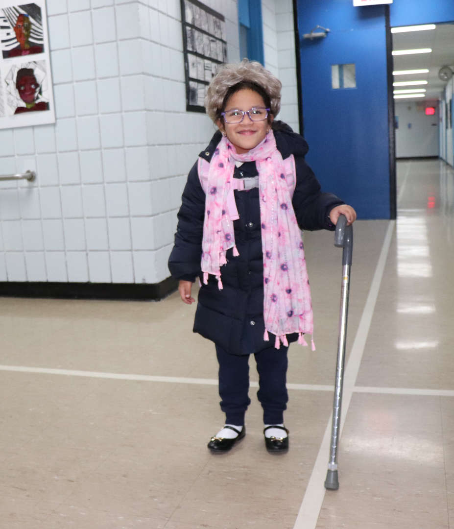 A student dressed like she is 100 years old with a scarf for Valentine's Day.