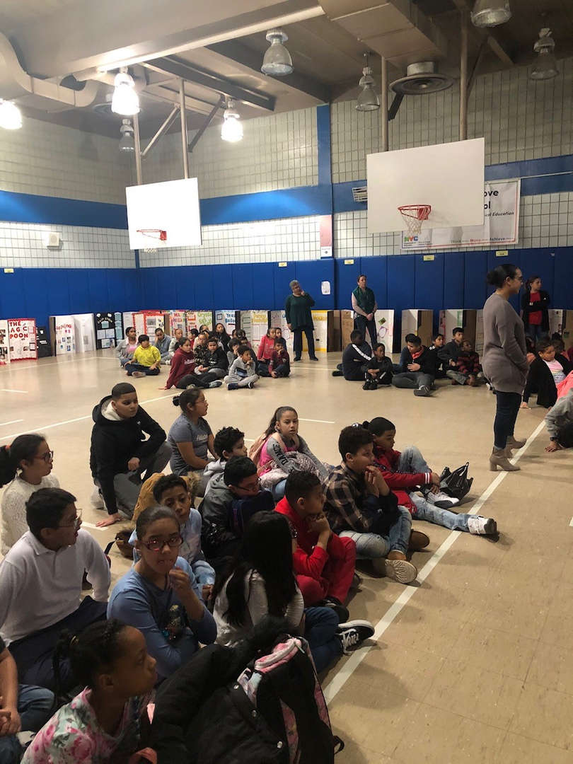 Students waiting to hear the results of the science fair.