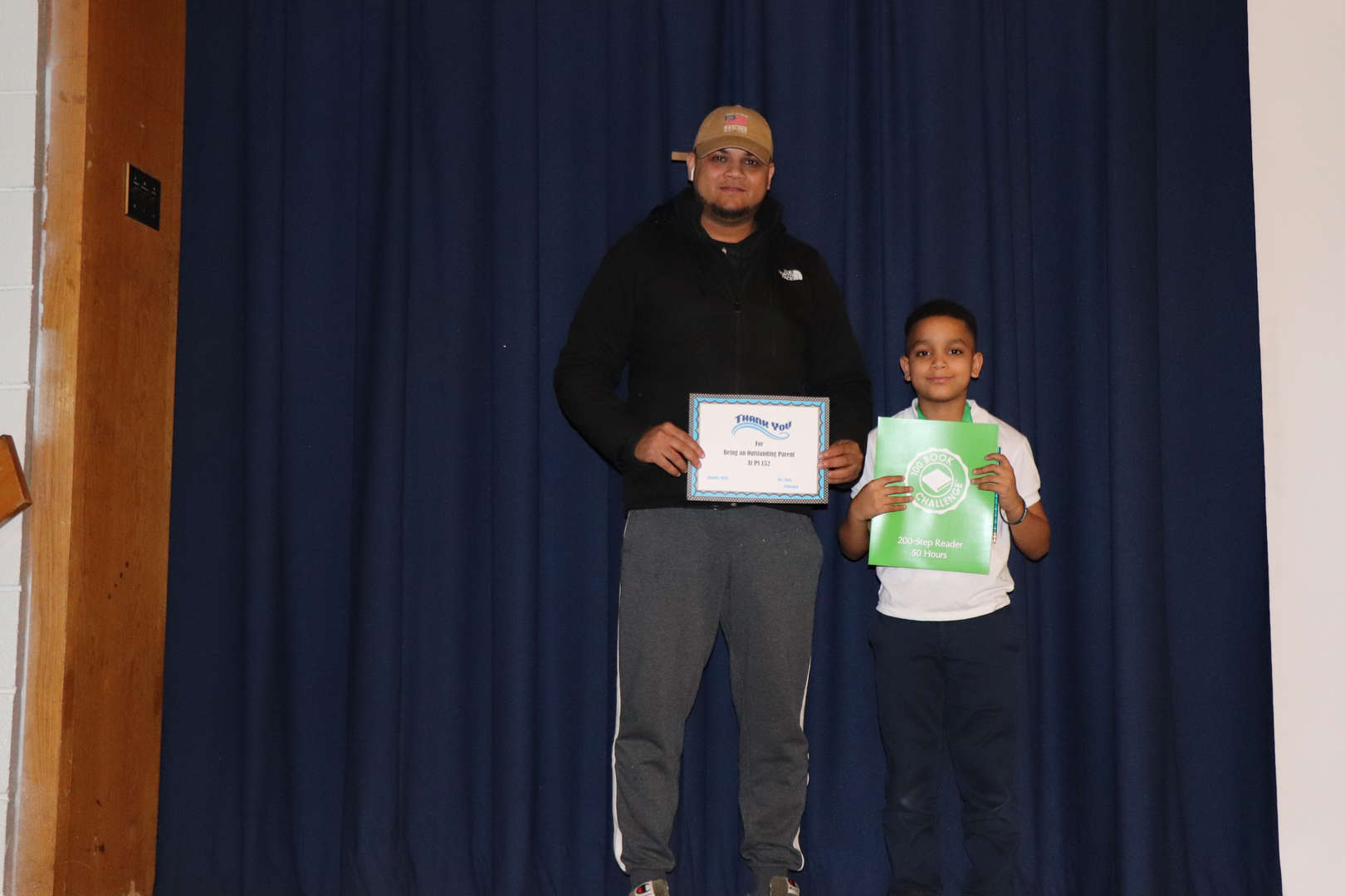 Parent with his child who is student of the month.