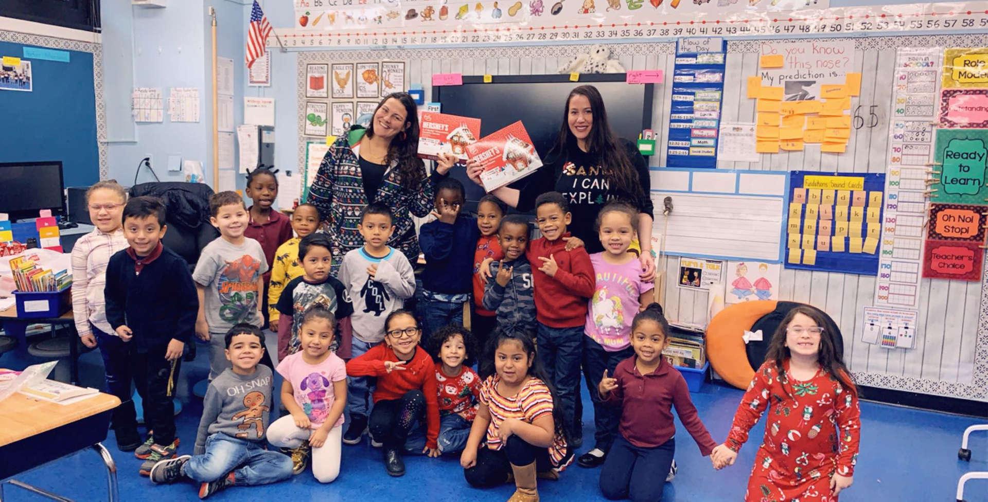 Ms. gribbins and Ms. Kajatazi with a kindergarten class.