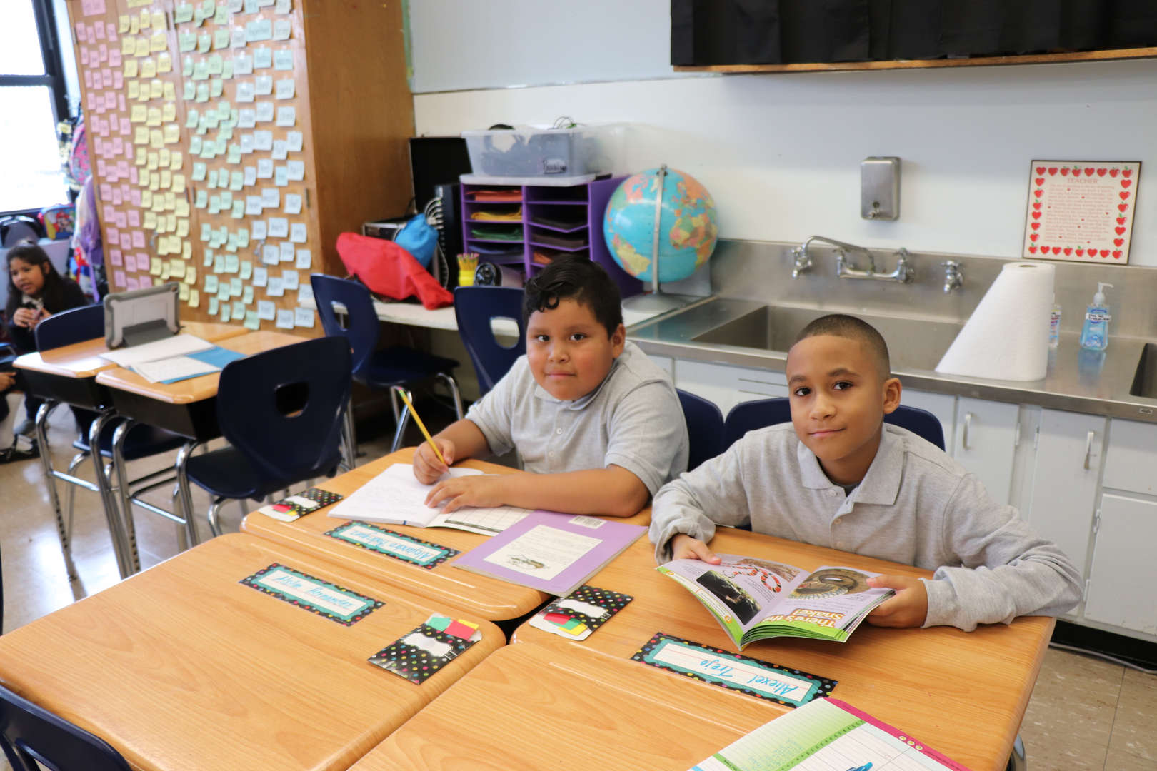 Students reading their books.