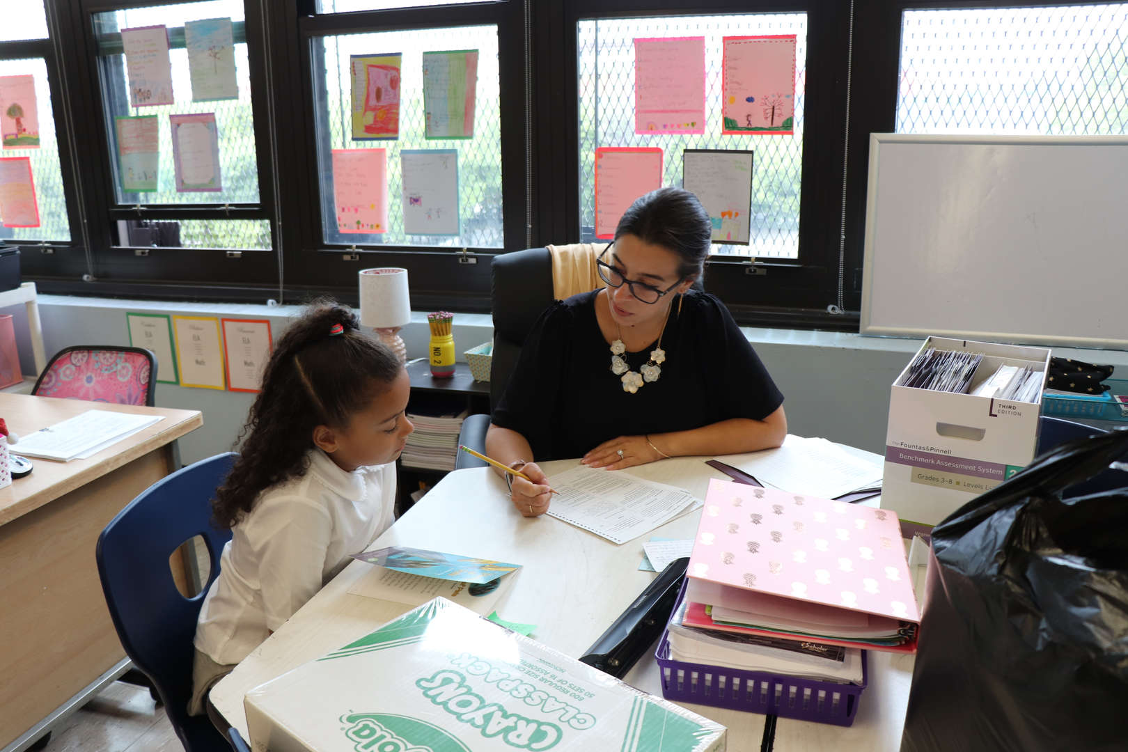 Ms. Parrino working one to one with a student.