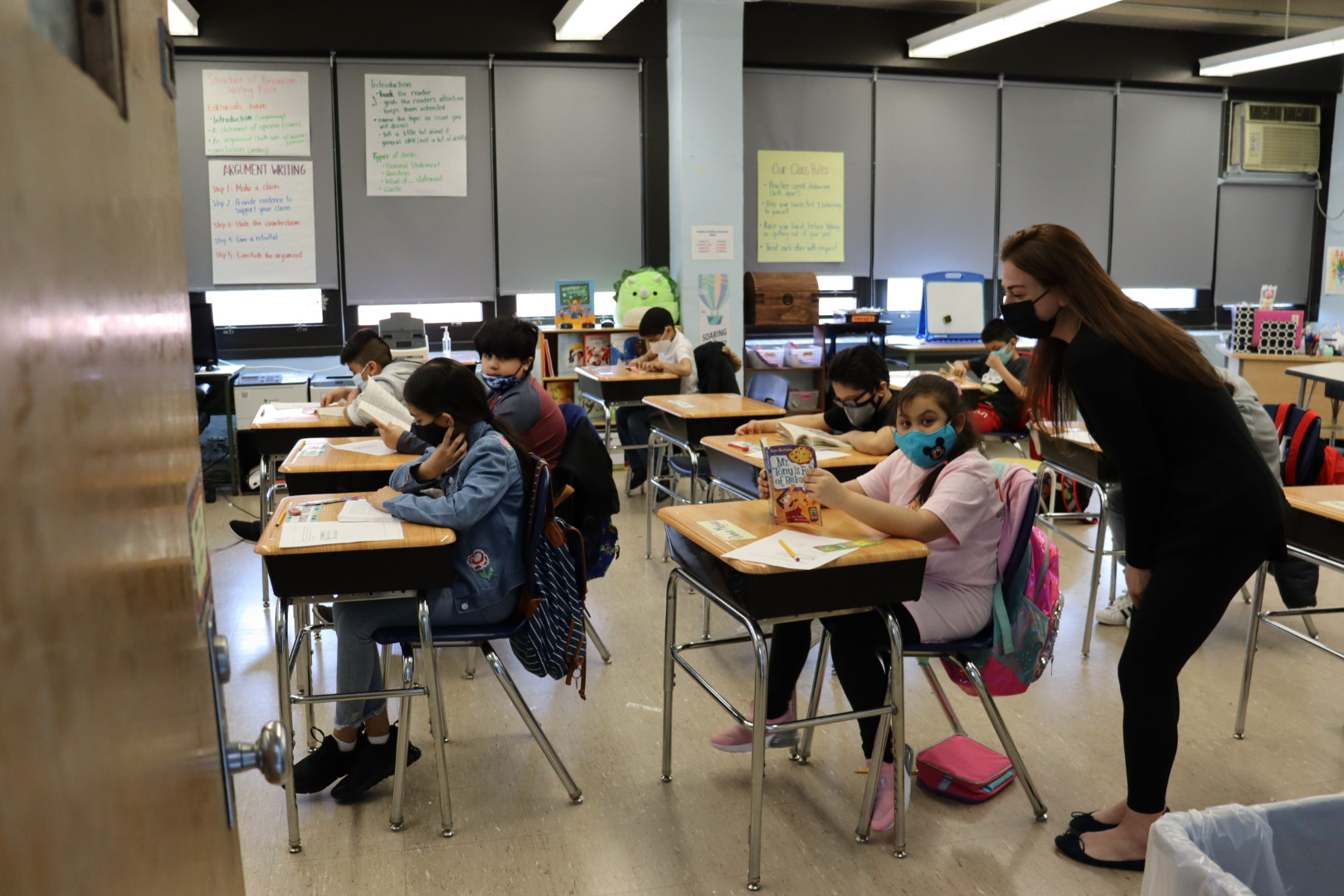 Ms. Garitee and her students reading