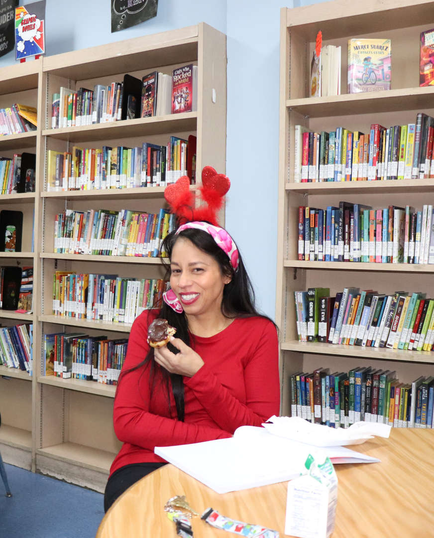 Ms. Delgado dressed in red for Valentine's Day.
