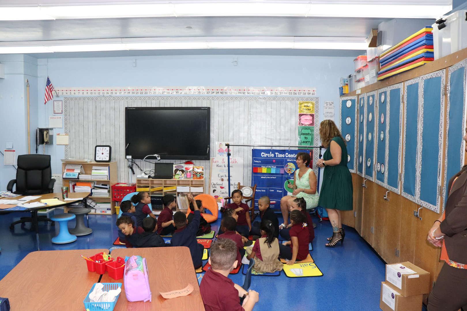 Mrs. Baez visiting a kindergarten class.
