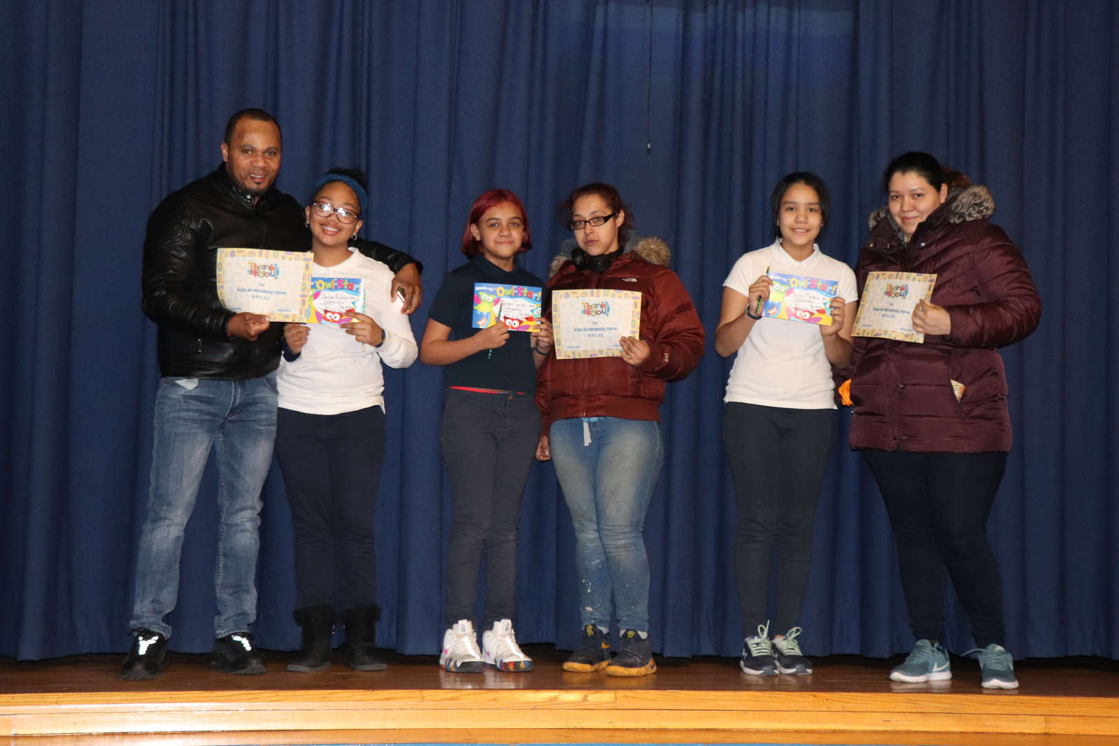 Fifth Grade Parent with their children who are students of the month.