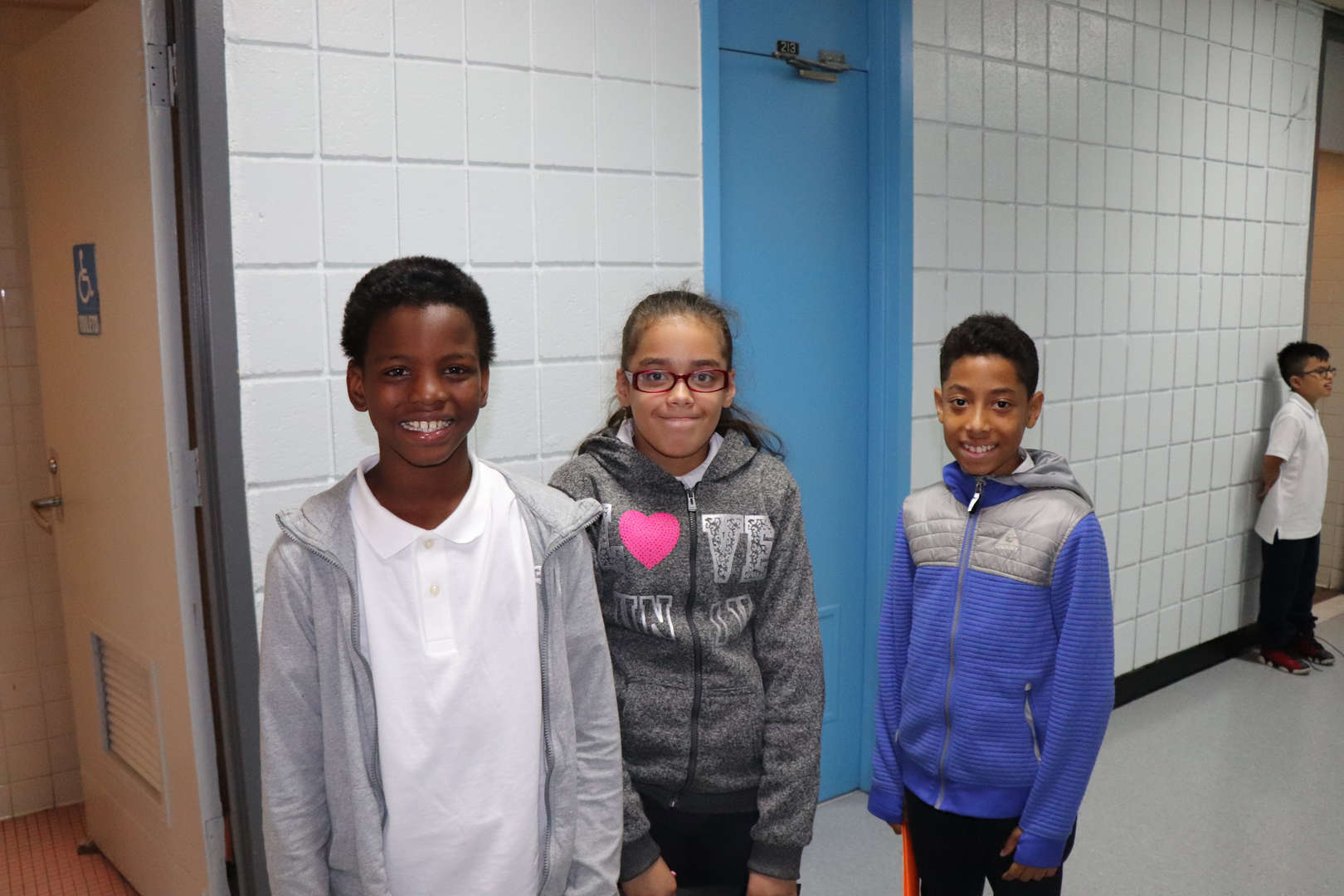 Fifth grade students walking to class.