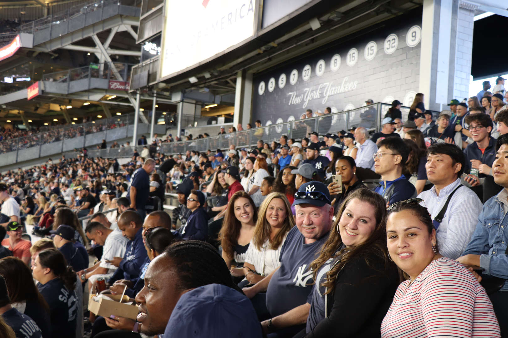 PS 152 Staff at the Yankee game.
