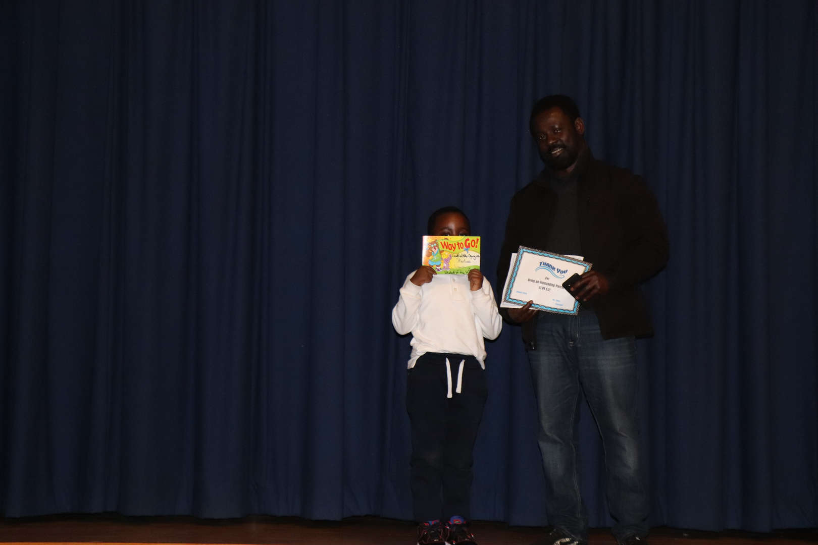 Second Grade Parent with his child who is student of the month.