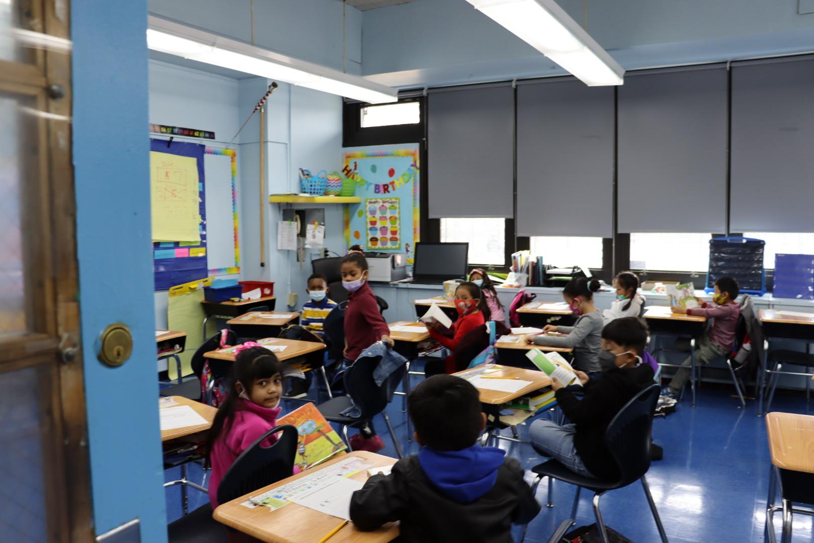 Mr. Morgan's 1st graders reading.
