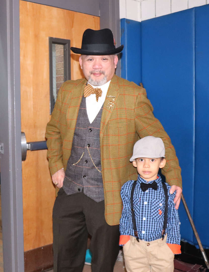 Mr. Yip and a student dressed like they are 100 years old.
