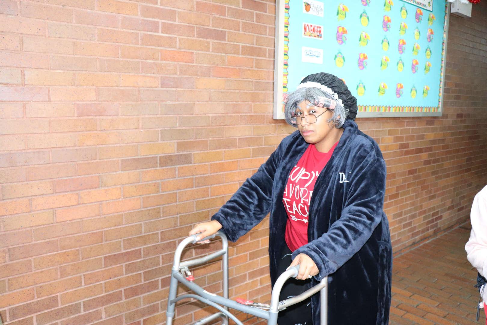 Mrs. Watkins dressed like she is 100 years old.