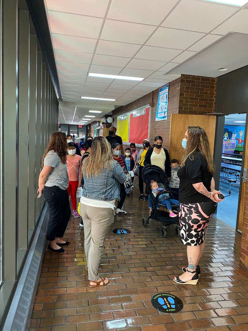 Mrs. Baez and a few teachers giving parents and students a tour.