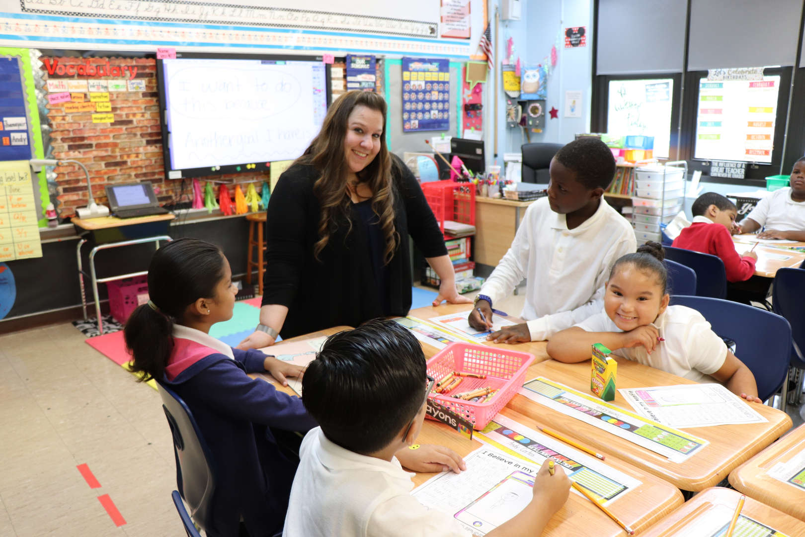 Mrs. McGuire teaching her students.