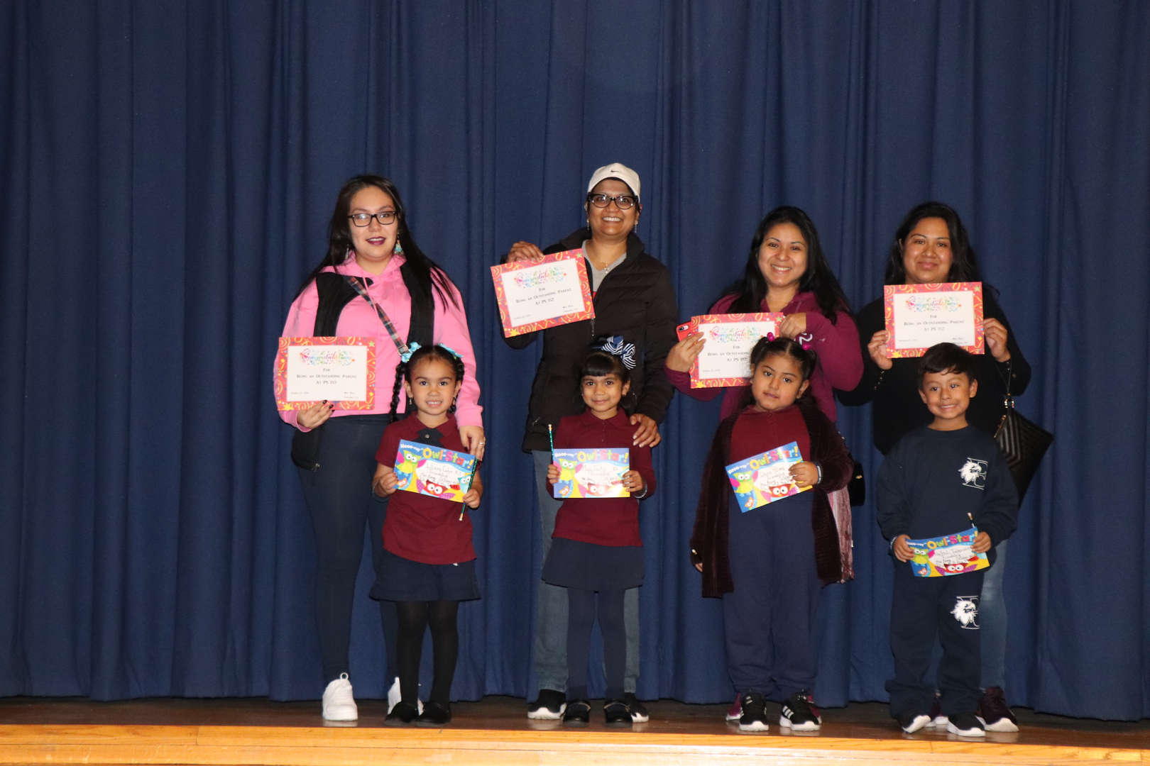 Kindergarten parents with the children who are student of the month.