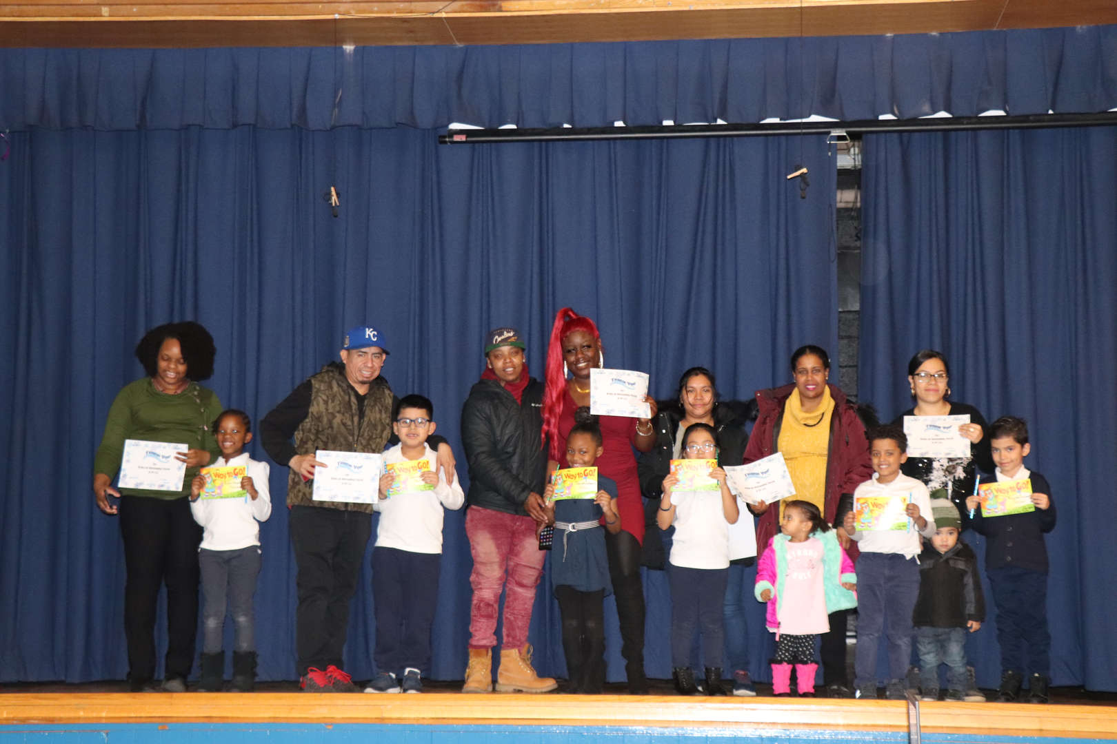 First Grade parents with their children who are students of the month.